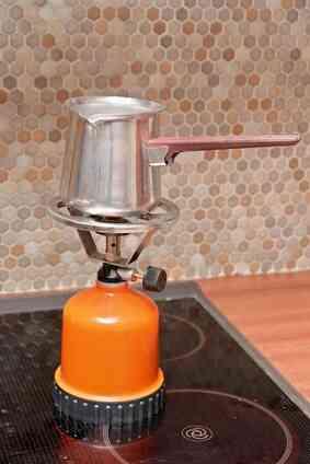 La protección de un Glasstop Estufa De Porcelana de Utensilios de cocina