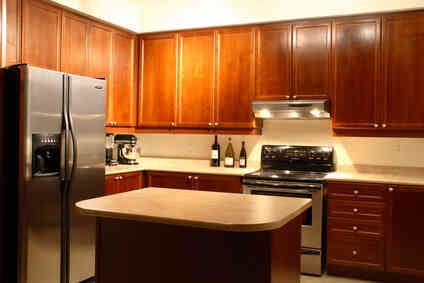 ¿Cómo puedo Proteger una Encimera de Cocina Eléctricos, Sartenes, Crockpots, Etc.?